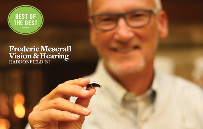 Fred Meserall with hearing aid
