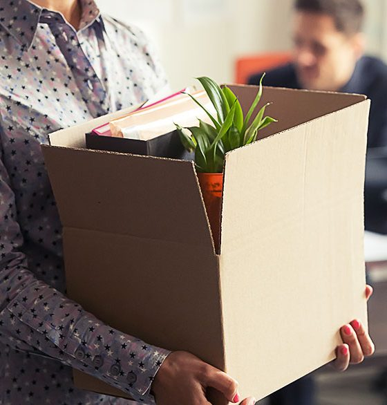 fired employee leaving office with things in a box