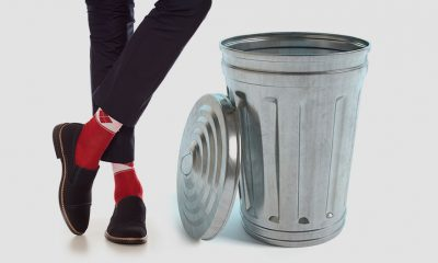 legs beside trash can