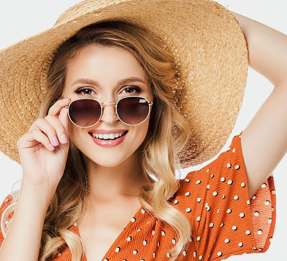 smiling lady wearing sunglasses
