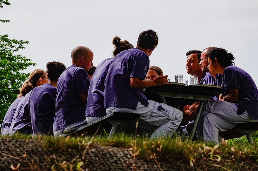 group of people eating at a table