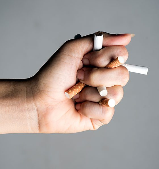 hand with cigarette sticks