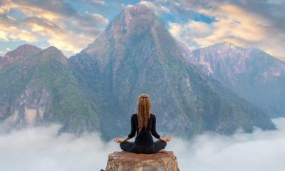 lady meditating facing mountains