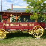 Pend Oreille Vision Care signage on an old horse wagon