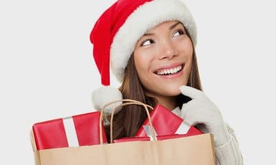 smiling lady wearing Christmas hat