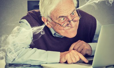 angry old man infront of laptop