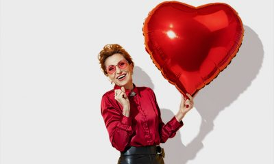 lady in red holding heart balloon