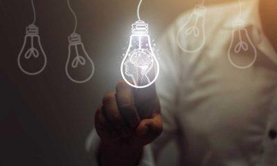 man touching light bulb