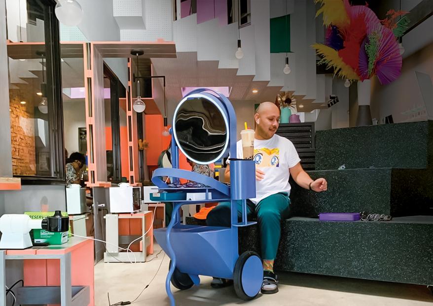 Optician Jonathen on a virtual fitting consult at one of Gogosha Optique's 'futuristic vanity pods'.