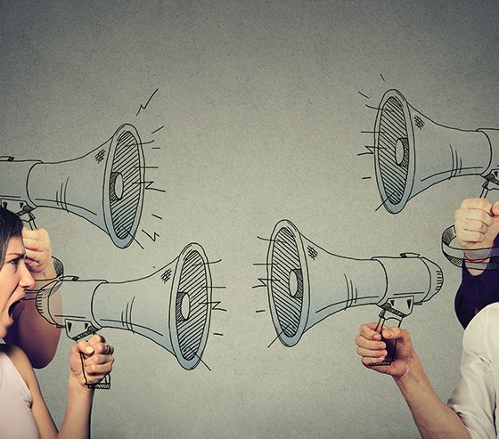 2 groups with megaphones shouting at each other