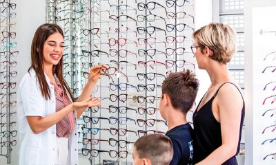 mom and son in eyeglasses store