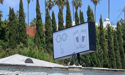 A billboard sits atop Gogosha Optique on Los Angeles' iconic Sunset Boulevard.